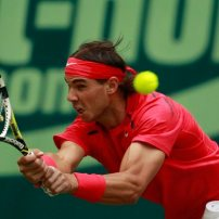 Nadal of Spain returns the ball to Kohlschreiber of Germany at the Halle Open ATP tennis tournament in Halle